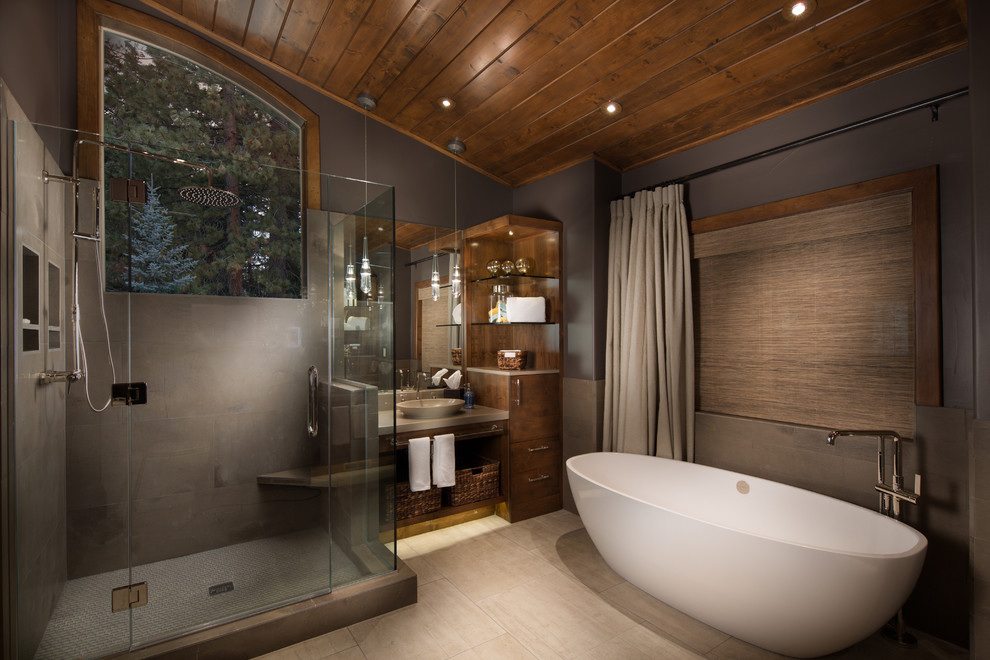 Photo of a country bathroom in Sacramento with a vessel sink, flat-panel cabinets, dark wood cabinets, a freestanding tub and an alcove shower.