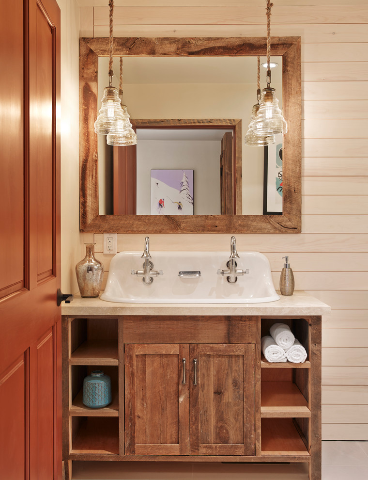 Example of a mountain style bathroom design in Houston with medium tone wood cabinets, a trough sink and shaker cabinets