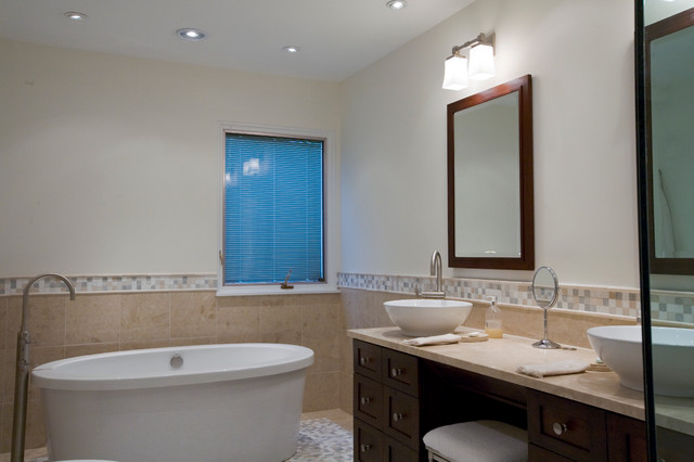 Example of a large trendy master beige tile and porcelain tile mosaic tile floor bathroom design in Bridgeport with a vessel sink, furniture-like cabinets, dark wood cabinets, marble countertops, a two-piece toilet and white walls