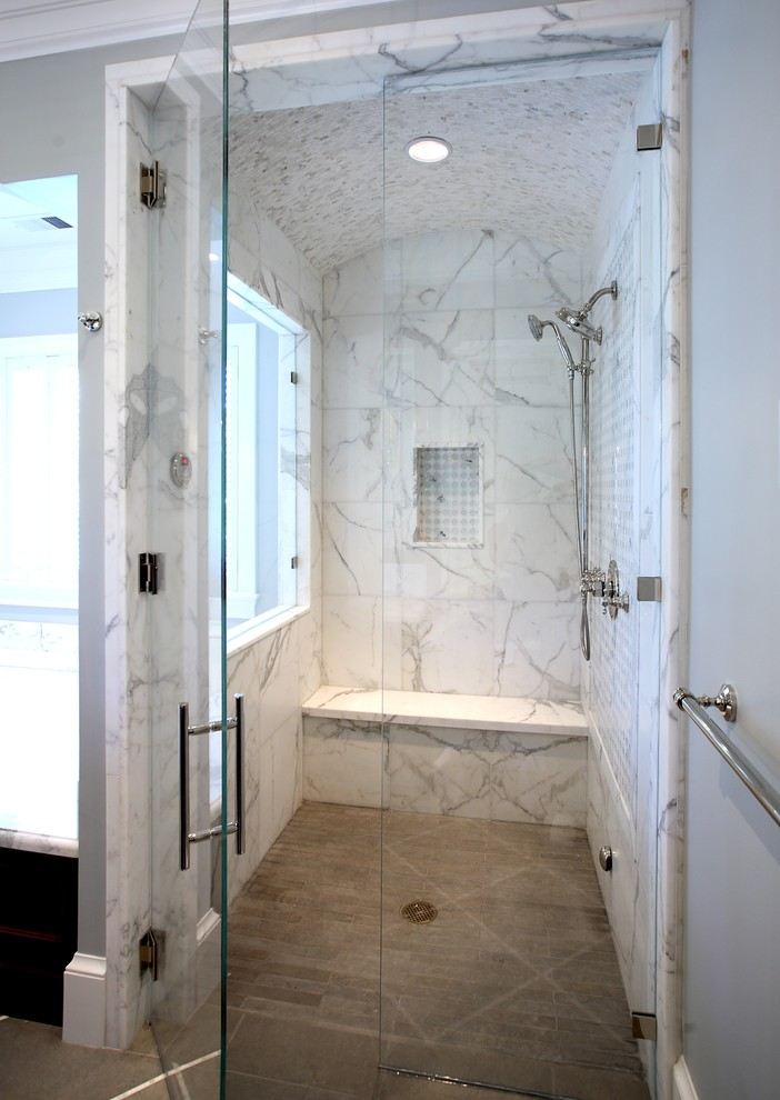 Inspiration for a timeless white tile and marble tile bathroom remodel in San Francisco with a niche