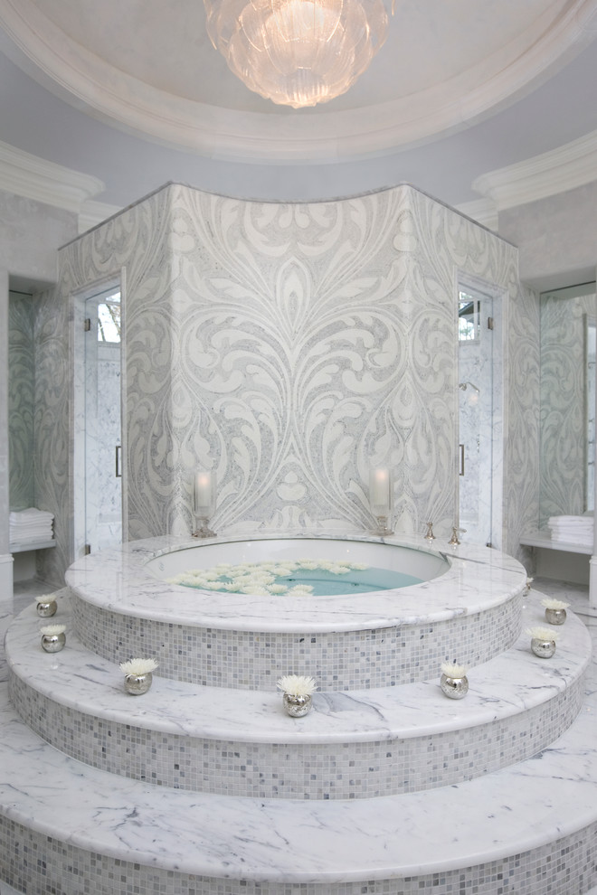 Inspiration for a mediterranean gray tile and mosaic tile bathroom remodel in Atlanta with a hot tub