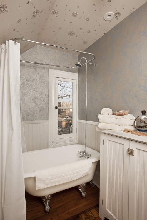 tiny freestanding tub and shower combination