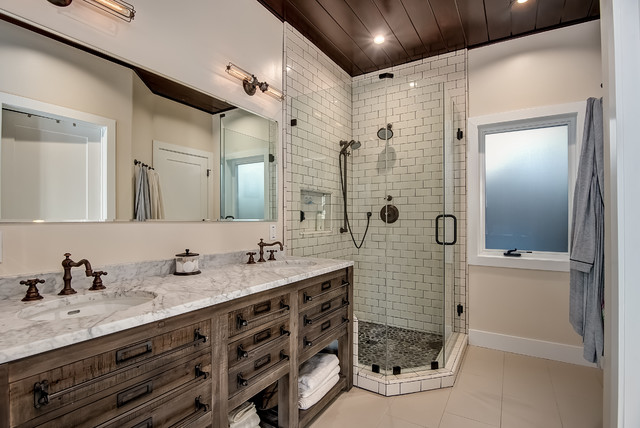 Corner shower - rustic 3/4 white tile corner shower idea in Orange County with flat-panel cabinets, medium tone wood cabinets, beige walls, an undermount sink, marble countertops and a hinged shower door