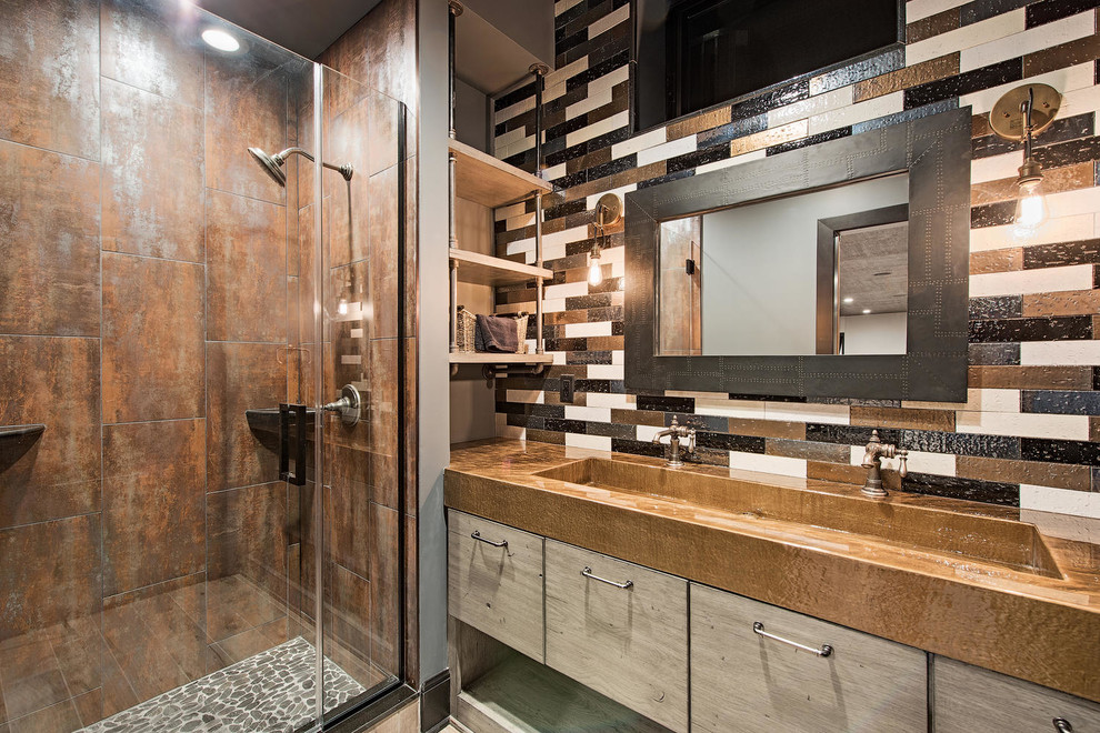 Inspiration for a mid-sized transitional 3/4 brown tile, multicolored tile and metal tile light wood floor and brown floor alcove shower remodel in Cleveland with flat-panel cabinets, multicolored walls, a trough sink, light wood cabinets, zinc countertops, a hinged shower door and brown countertops