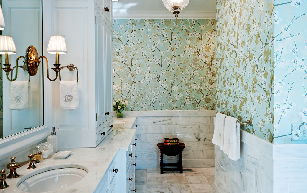 Example of a mid-sized classic marble floor bathroom design in Nashville with marble countertops, an undermount sink, white cabinets and multicolored walls