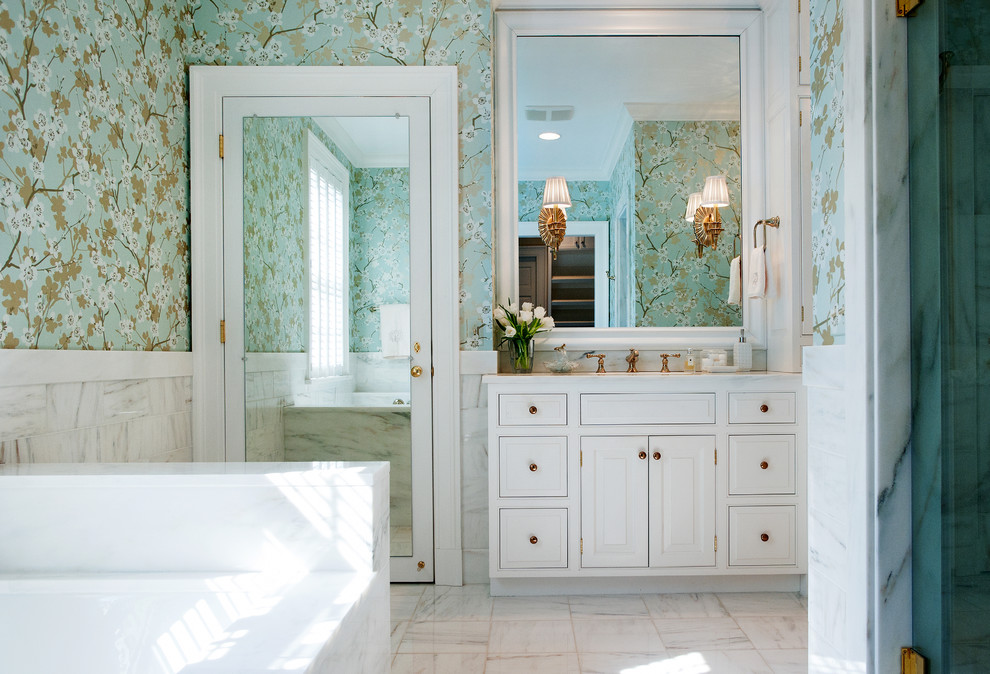 Mid-sized elegant white tile marble floor bathroom photo in Nashville with raised-panel cabinets, white cabinets, an undermount sink, marble countertops and multicolored walls