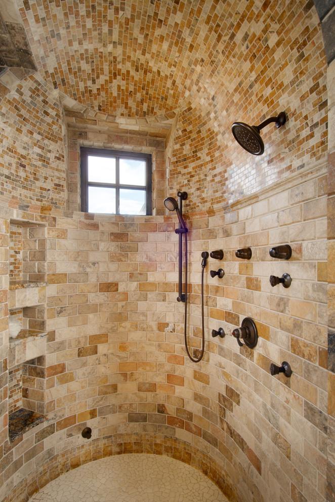 Example of a tuscan beige tile bathroom design in Denver