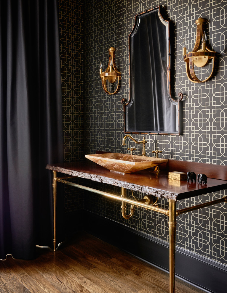 Example of a trendy medium tone wood floor bathroom design in Raleigh with black walls and a console sink