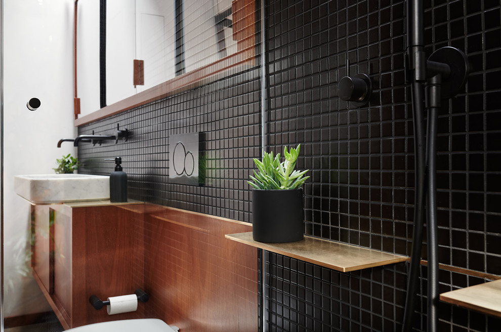 Bathroom - small modern master black tile and ceramic tile concrete floor and gray floor bathroom idea in San Francisco with flat-panel cabinets, medium tone wood cabinets, a wall-mount toilet, black walls and a pedestal sink