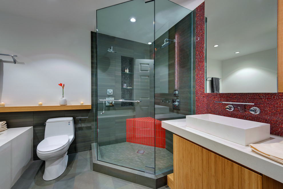 Bathroom - small modern 3/4 mosaic tile and red tile porcelain tile and gray floor bathroom idea in San Francisco with a vessel sink, open cabinets, a two-piece toilet, white walls, a hinged shower door, light wood cabinets, quartz countertops and a niche