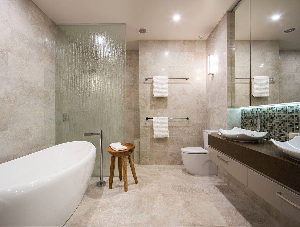 Bathroom - contemporary mosaic tile and beige tile bathroom idea in Melbourne with a vessel sink, flat-panel cabinets, gray cabinets, a two-piece toilet and beige walls