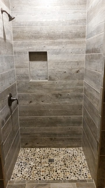 Barnwood tile shower with pebble base rustic bathroom for Cabin shower tile ideas