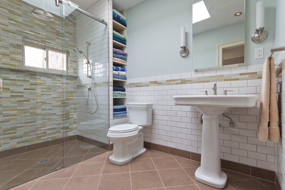 Example of a classic walk-in shower design in New York with a pedestal sink
