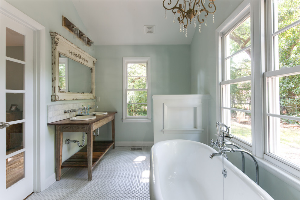 Freestanding bathtub - mid-sized cottage gray tile and marble tile mosaic tile floor and white floor freestanding bathtub idea in Charleston with a drop-in sink, blue walls, distressed cabinets and open cabinets