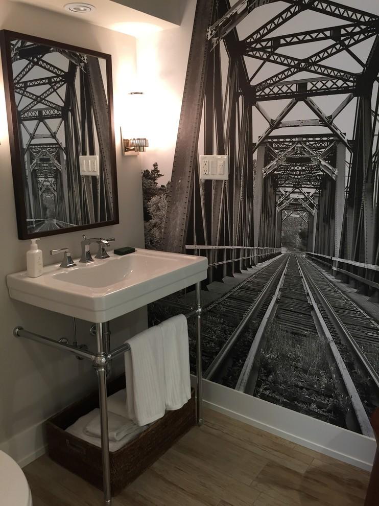 Bathroom - small industrial 3/4 porcelain tile porcelain floor bathroom idea in Toronto with a wall-mount sink