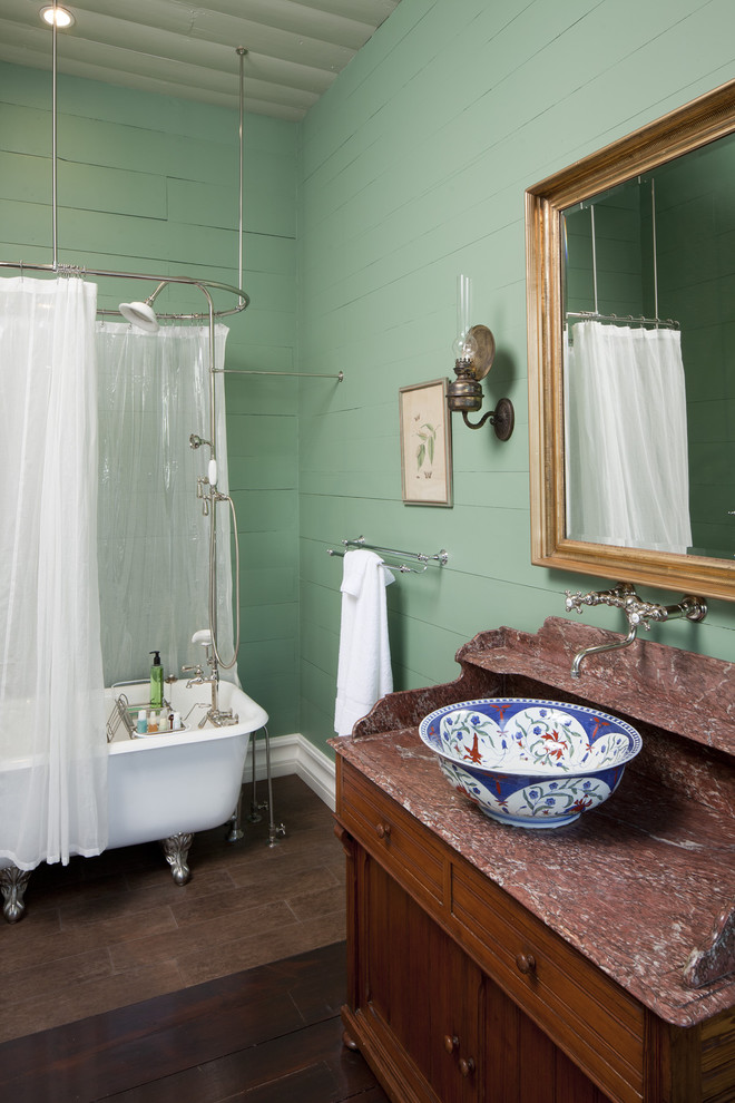 Inspiration for a farmhouse bathroom remodel in Austin with a vessel sink and green walls