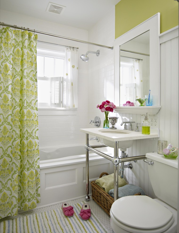 Drop-in bathtub - traditional white tile drop-in bathtub idea in Other with an undermount sink, a two-piece toilet and green walls