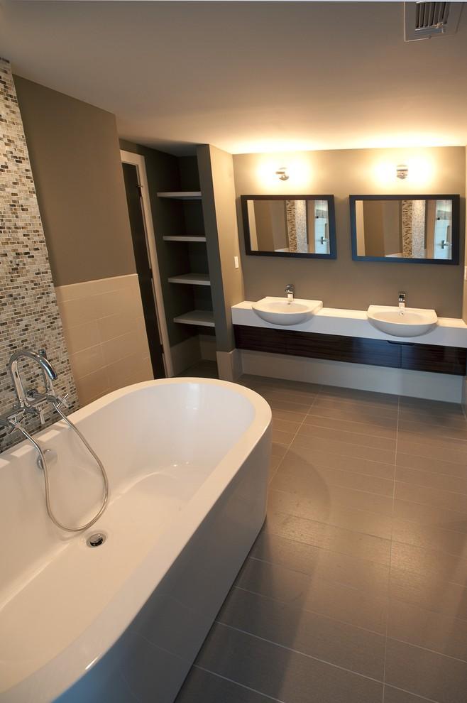 Freestanding bathtub - contemporary mosaic tile freestanding bathtub idea in Atlanta