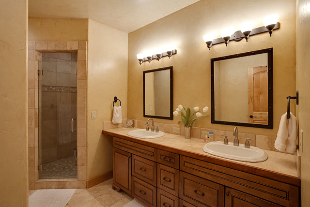 Bath remodel on Lake Minnetonka with Travertine Floor and Shower traditional-bathroom