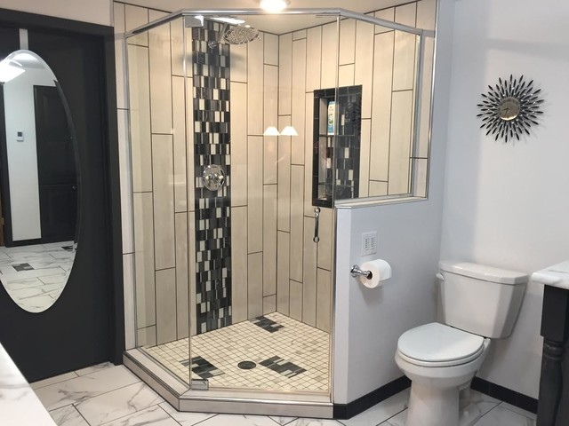 Example of a large trendy 3/4 porcelain floor and multicolored floor corner shower design in Other with raised-panel cabinets, gray cabinets, gray walls, an undermount sink, laminate countertops and a hinged shower door
