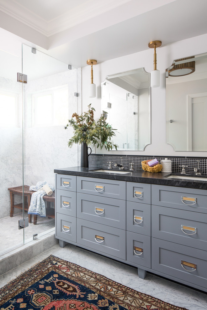 Alcove shower - large transitional master black tile and stone tile marble floor alcove shower idea in Los Angeles with shaker cabinets, gray cabinets, a one-piece toilet, white walls, an undermount sink, marble countertops and a hinged shower door