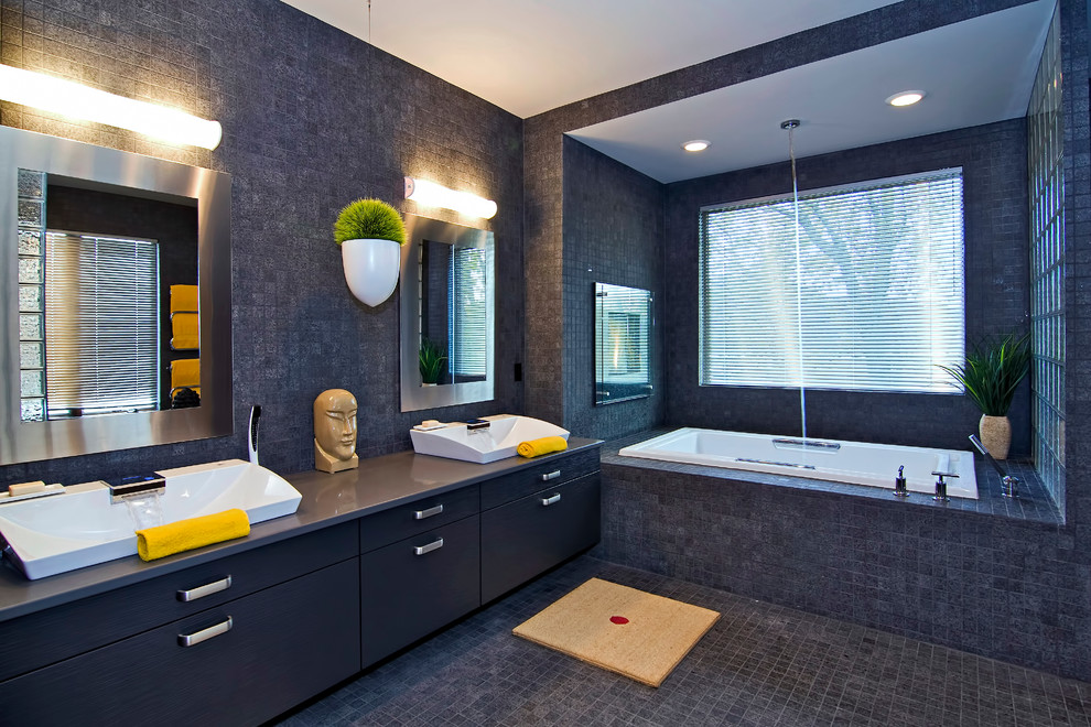 Inspiration for a contemporary gray tile bathroom remodel in Minneapolis with a vessel sink, flat-panel cabinets, black cabinets and gray walls