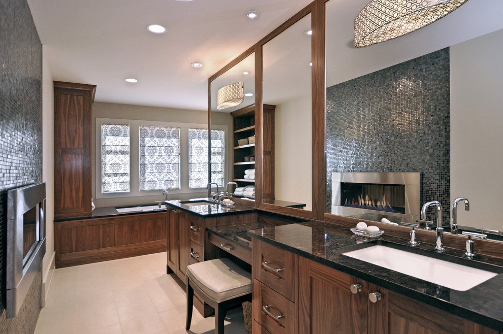 Bathroom - transitional mosaic tile and gray tile bathroom idea in Calgary with shaker cabinets, dark wood cabinets, an undermount tub, beige walls, an undermount sink and granite countertops