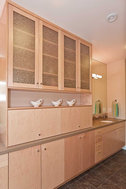 bathroom cabinet between double sinks in familiy bathroom modern