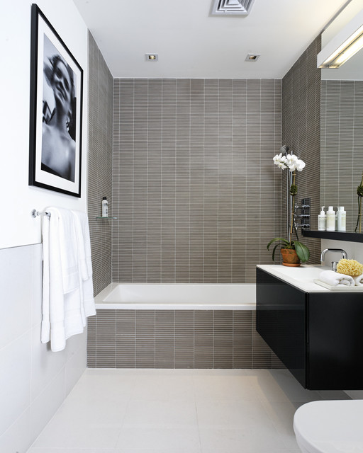 Inspiration for a contemporary gray tile and mosaic tile bathroom remodel in New York with flat-panel cabinets, black cabinets and white countertops