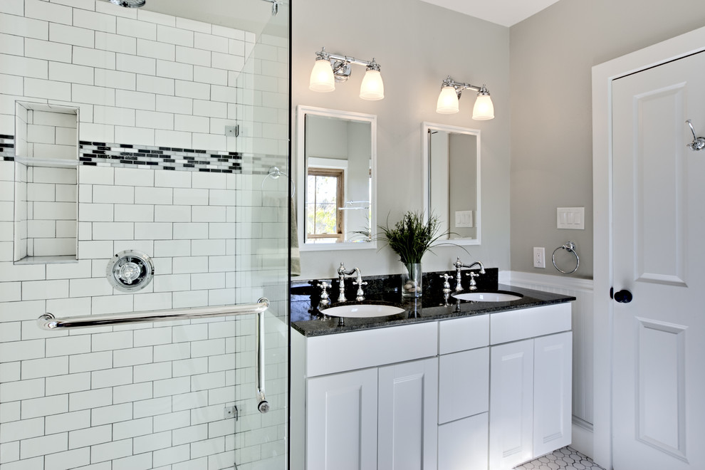 Example of a classic white tile and subway tile alcove shower design in New York with an undermount sink, recessed-panel cabinets and white cabinets
