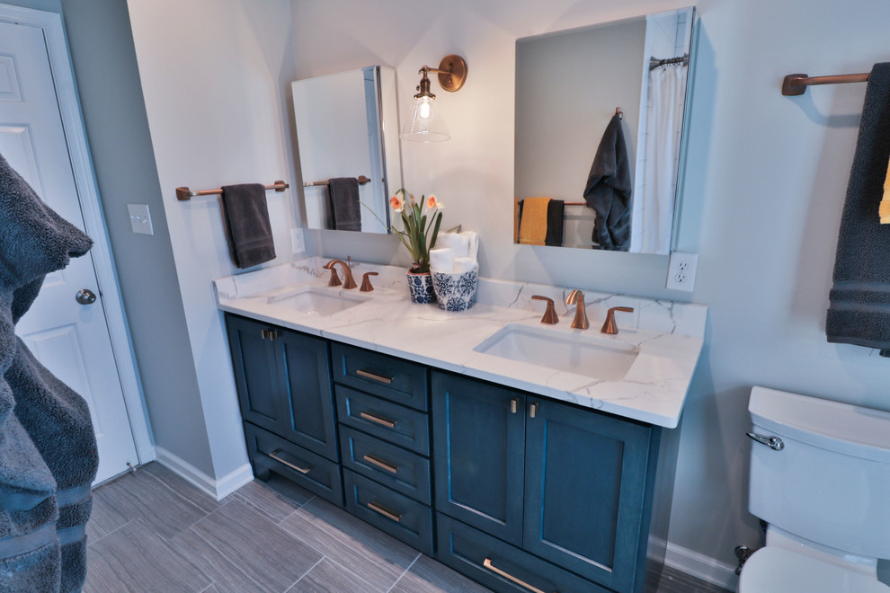Example of a mid-sized transitional 3/4 white tile and subway tile porcelain tile and brown floor bathroom design in DC Metro with recessed-panel cabinets, blue cabinets, gray walls, an undermount sink, marble countertops and white countertops
