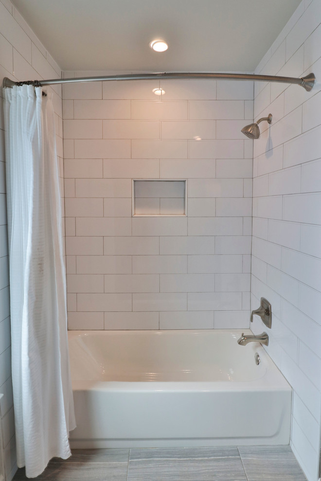 Bathroom - mid-sized transitional 3/4 white tile and subway tile porcelain tile and brown floor bathroom idea in DC Metro with recessed-panel cabinets, blue cabinets, gray walls, an undermount sink, marble countertops and white countertops