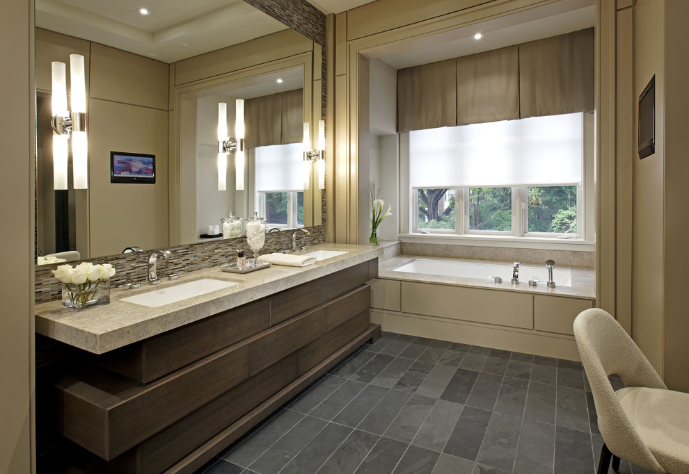 Bathroom - large contemporary master beige tile slate floor bathroom idea in Toronto with an undermount sink, an undermount tub, dark wood cabinets, beige walls and granite countertops