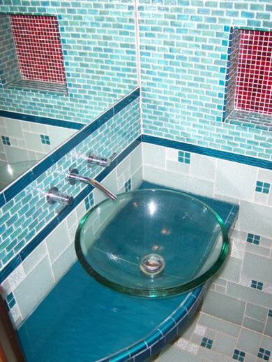 Bathroom featuring glass vanity and glass tile surround