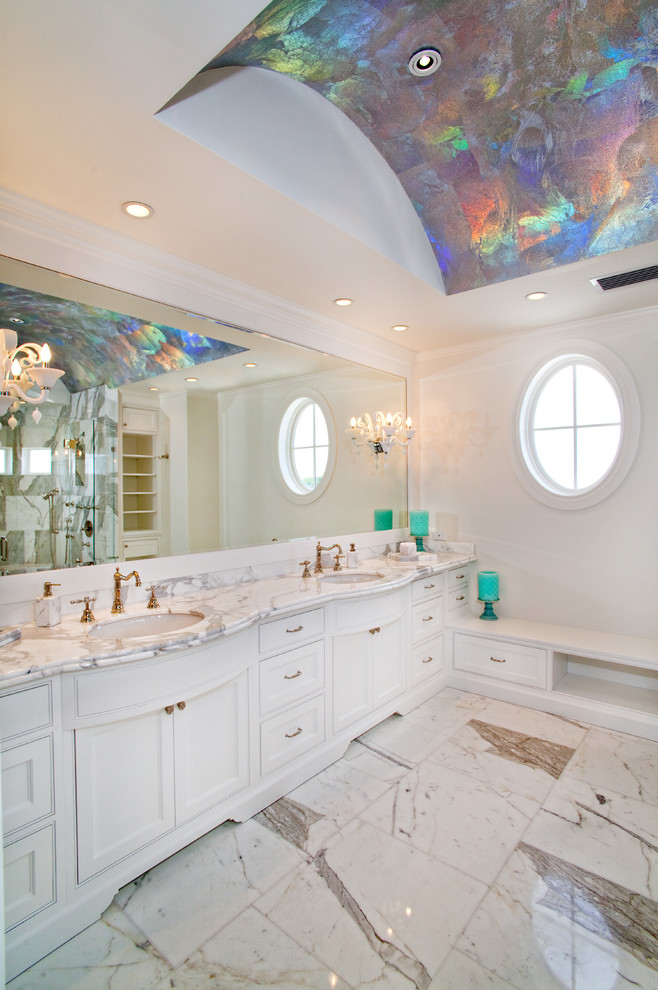 Inspiration for a large timeless master marble floor and white floor bathroom remodel in Miami with an undermount sink, beaded inset cabinets, white cabinets, white walls, marble countertops and white countertops