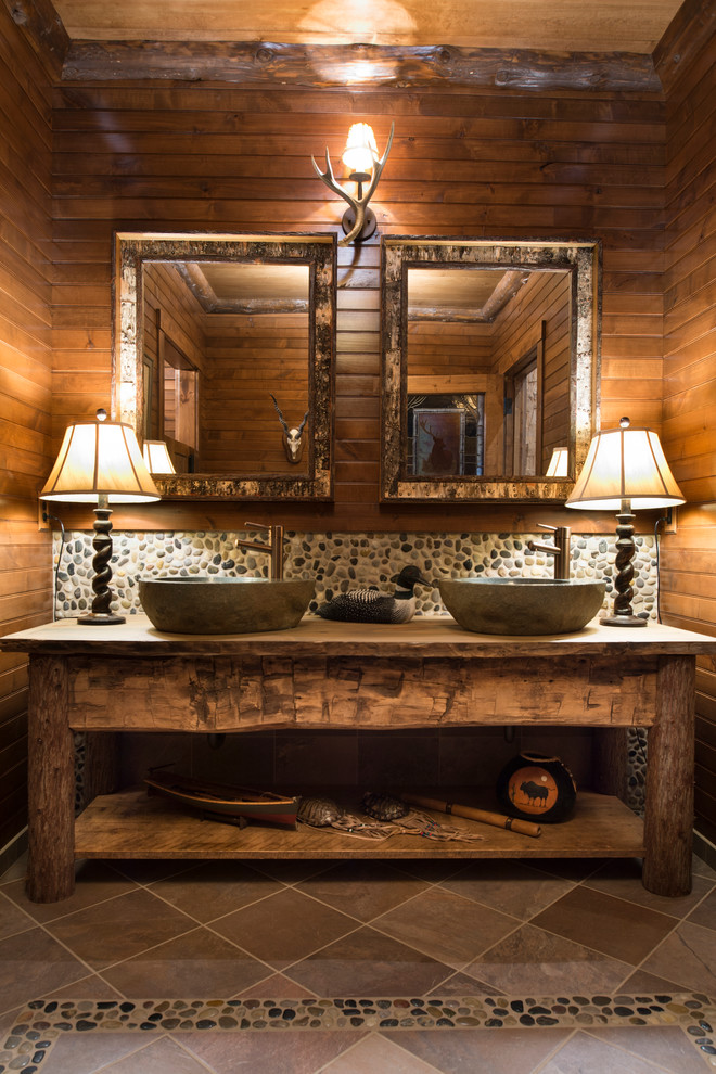 Example of a mountain style pebble tile pebble tile floor bathroom design in Minneapolis with a vessel sink