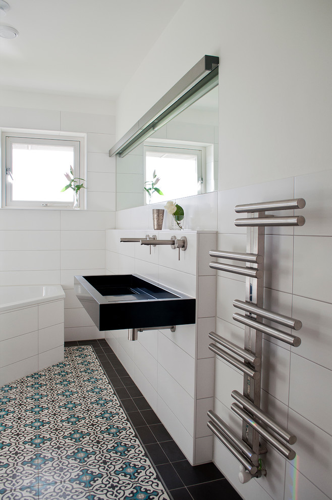 Example of a small trendy bathroom design in Amsterdam with a trough sink and white walls
