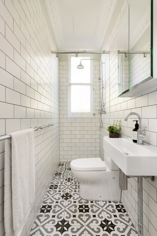 Inspiration for a transitional white tile and subway tile multicolored floor and single-sink bathroom remodel in Sydney with a console sink