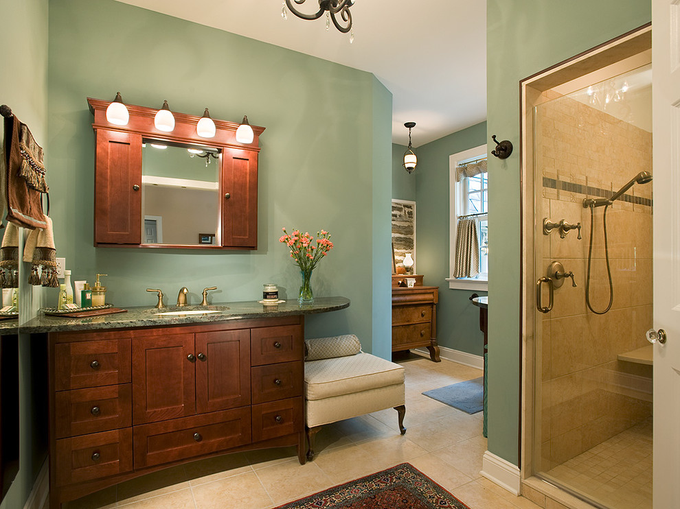 Example of a large classic master limestone floor and beige floor alcove shower design in Philadelphia with an undermount sink, shaker cabinets, dark wood cabinets, green walls, a two-piece toilet, granite countertops, a hinged shower door and green countertops