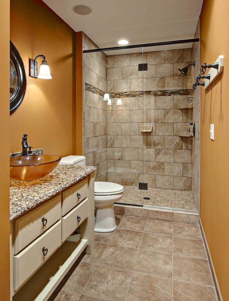 Elegant bathroom photo in Minneapolis with a vessel sink and orange walls