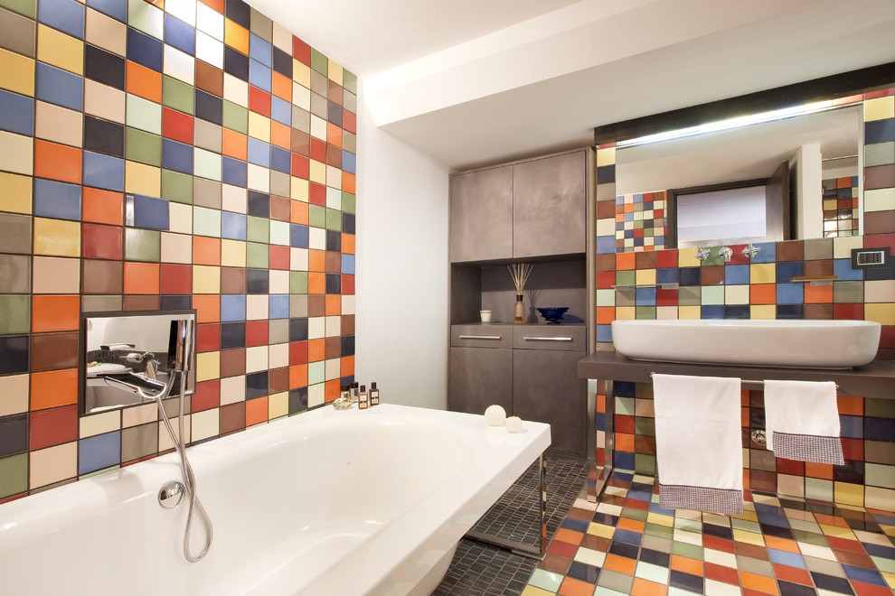 Mid-sized minimalist master ceramic tile ceramic floor and multicolored floor freestanding bathtub photo in Milan with a vessel sink and multicolored walls
