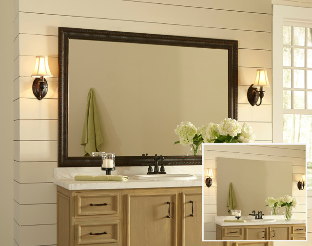Determine trim style and positioning of trim around mirror to obtain measurements specific to mirror being framed. Use measurements to cut lengths of primed MDF baseboard. Tip: Have materials cut at a home improvement store and consider using style of door casings in home as inspiration for the look.