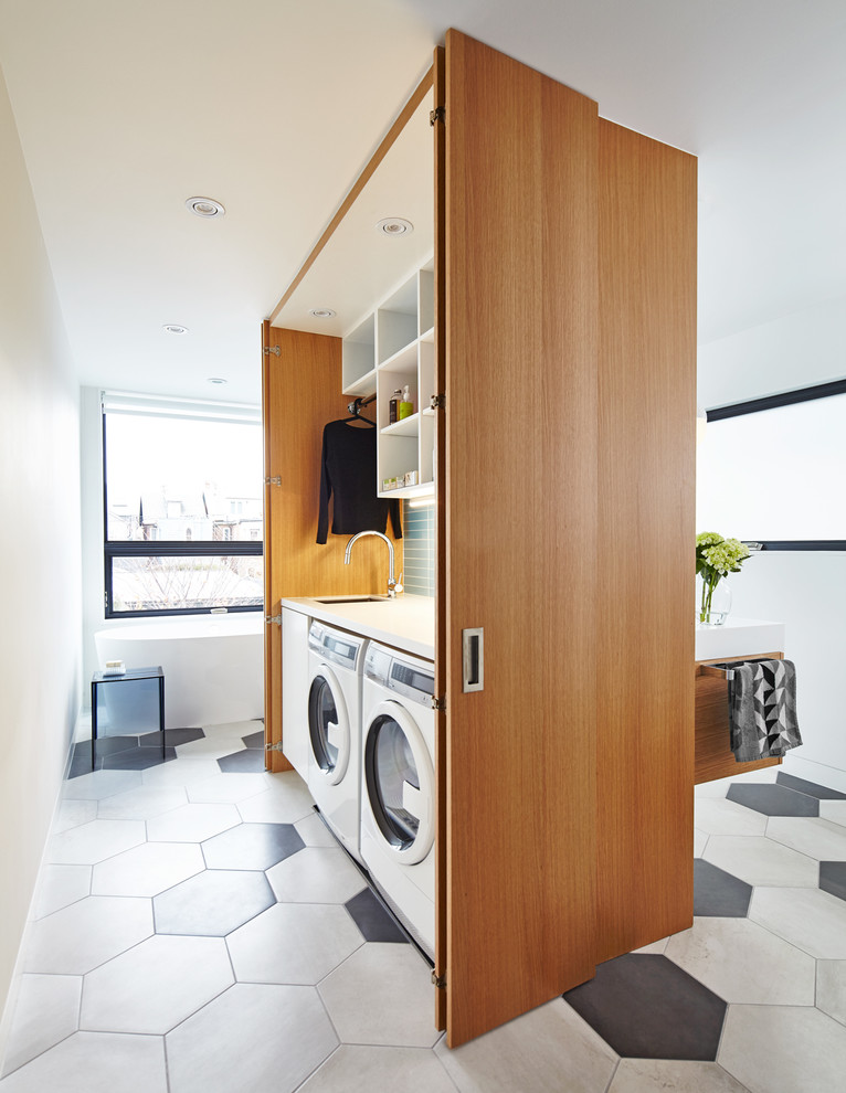 Mid-sized trendy porcelain tile and multicolored floor bathroom/laundry room photo in Toronto with open cabinets, white cabinets and white walls