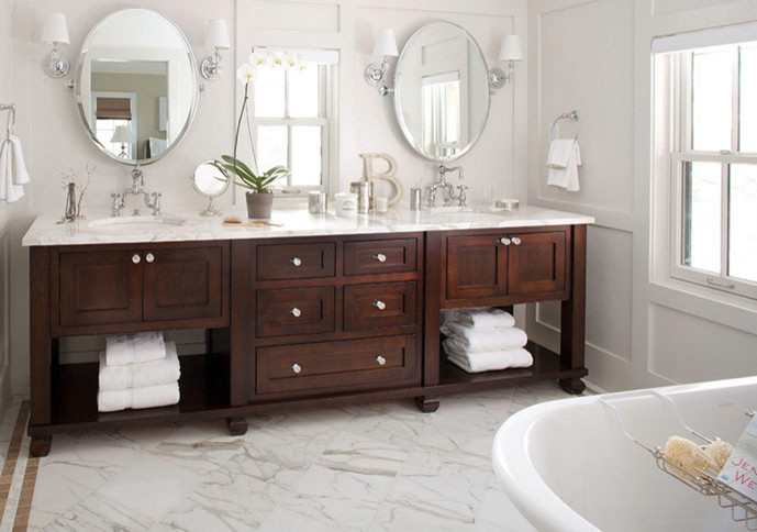 Inspiration for a large cottage master marble floor and white floor freestanding bathtub remodel in Las Vegas with shaker cabinets, dark wood cabinets, a two-piece toilet, white walls, an undermount sink and marble countertops