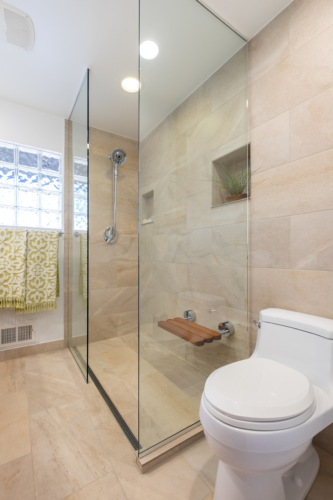 Walk-in shower - transitional master beige tile porcelain tile walk-in shower idea in Portland with flat-panel cabinets, medium tone wood cabinets, white walls, a drop-in sink and tile countertops