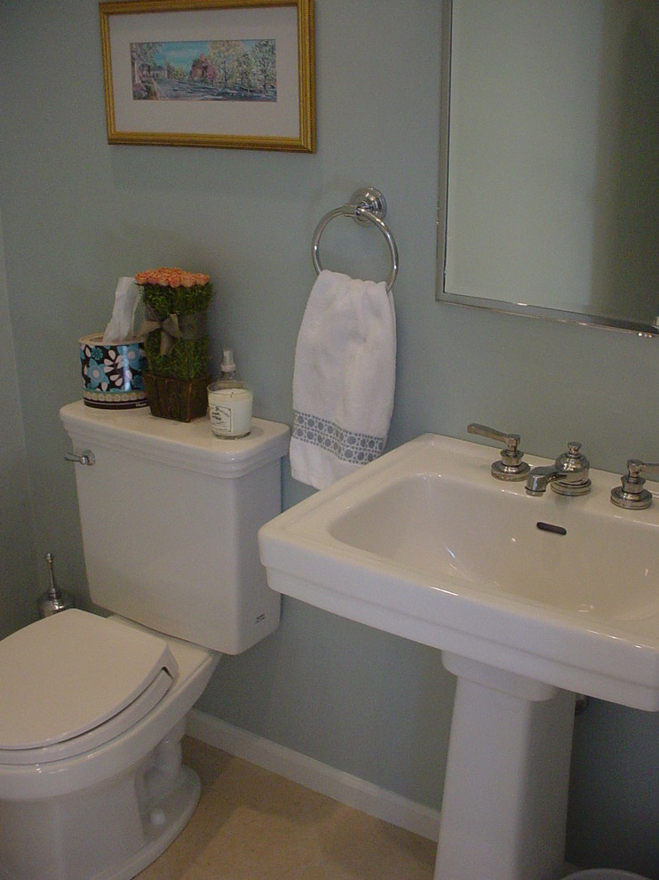 Bathroom - small contemporary 3/4 ceramic tile bathroom idea in Boston with a two-piece toilet, blue walls and a pedestal sink