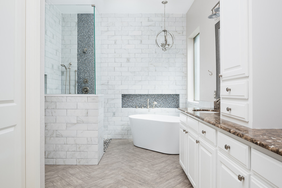 Bathroom - large modern master white tile and marble tile porcelain tile and beige floor bathroom idea in Dallas with shaker cabinets, white cabinets, a one-piece toilet, white walls, an integrated sink and marble countertops