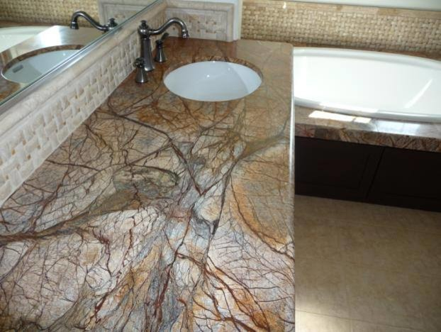 Inspiration for a mid-sized transitional beige tile and ceramic tile beige floor drop-in bathtub remodel in Houston with an undermount sink, granite countertops and brown countertops