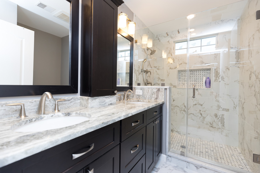 Mid-sized elegant 3/4 beige tile, gray tile and marble tile marble floor and gray floor alcove shower photo in DC Metro with recessed-panel cabinets, black cabinets, gray walls, an undermount sink, granite countertops and a hinged shower door