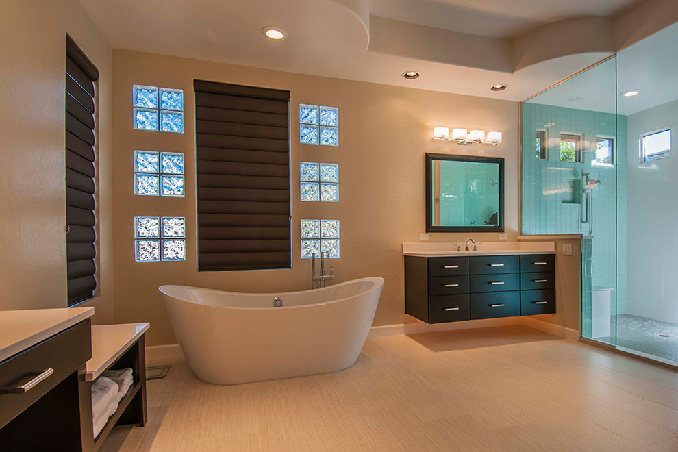 Example of a mid-sized minimalist master beige floor bathroom design in Orlando with beaded inset cabinets, white cabinets, a one-piece toilet, gray walls, an undermount sink and a hinged shower door